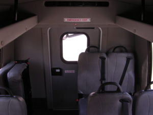 Interior of bus shown with some seating down.