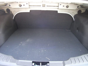 Inside of the trunk of a small fleet vehicle.