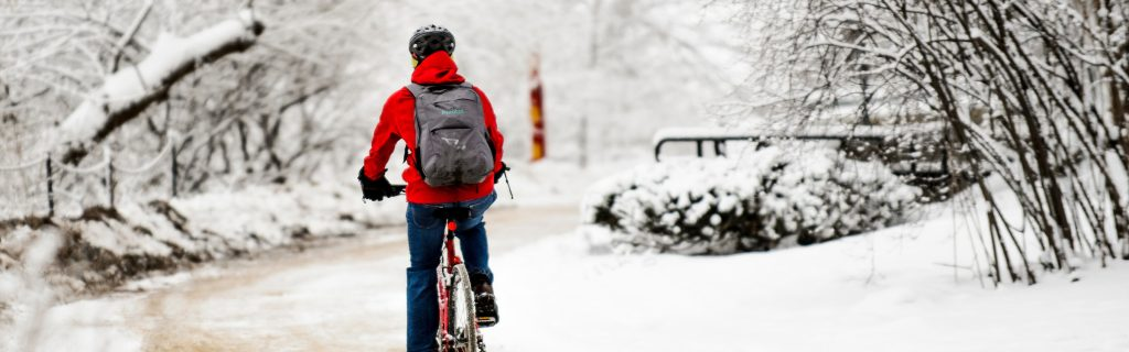 A cyclist makes their way along the snow-covered Howard Temin Lakeshore Path during winter at the University of Wisconsin-Madison on Jan. 26, 2016.
